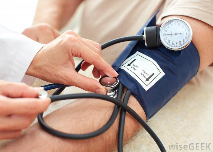 man-with-blue-blood-pressure-cuff-on-arm